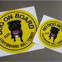 DOG ON BOA…