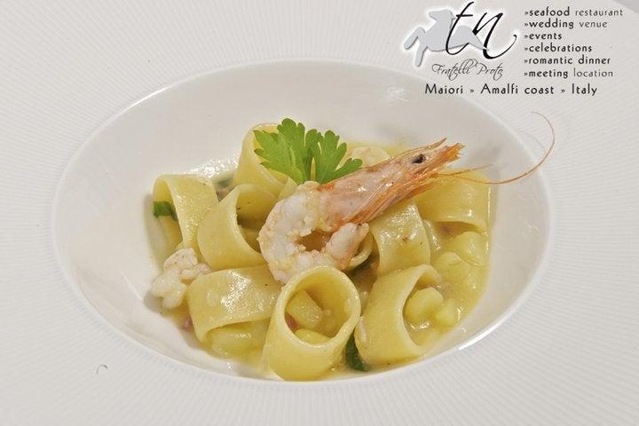 【彼女の恋した南イタリア】 - diario  イタリアリゾート最新情報    -塔のレストランのカラマラータ