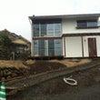丘の上に建つ家