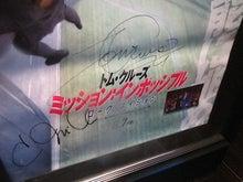 トムのサインと写真