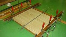 打ち敷きを収納に使用する桐材を接着