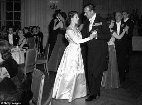 Queen Elizabeth dancing with Lord Louis Mountbat