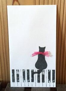 pianocat_envelope
