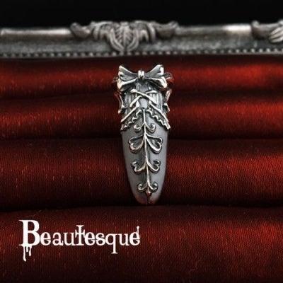 リボンデザインのネイルリング|ビュウテスク