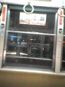 路面電車の映画館、上映中。百円だよ。