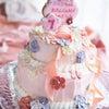 ドレスとお揃いの誕生日ケーキの画像