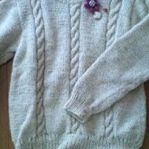 手編みのセーターのリ…