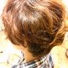 傷んだショートヘアにふんわりパーマの画像