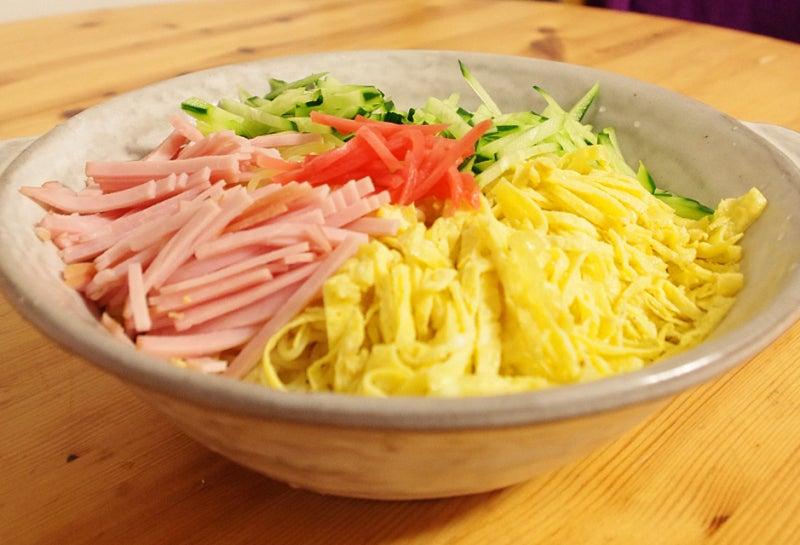 赤いジャージのひげ豆腐
