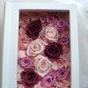 ●ピンクと濃い目赤紫のフォトブックフレームとお父様用ブートニアをお届けしました。の画像