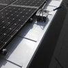 ソーラーパネルの合間から断熱塗装なう。の画像
