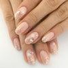 ふんわりピンク×ラメ&雪の結晶ネイルの画像