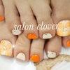元気が出るオレンジカラー☆お花フットネイルの画像