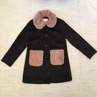 娘のコートの記事に添付されている画像
