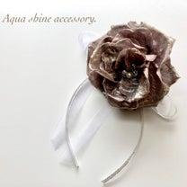 結婚式にぴったりなレジュフラワーの薔薇のコサージュ feat...の記事に添付されている画像