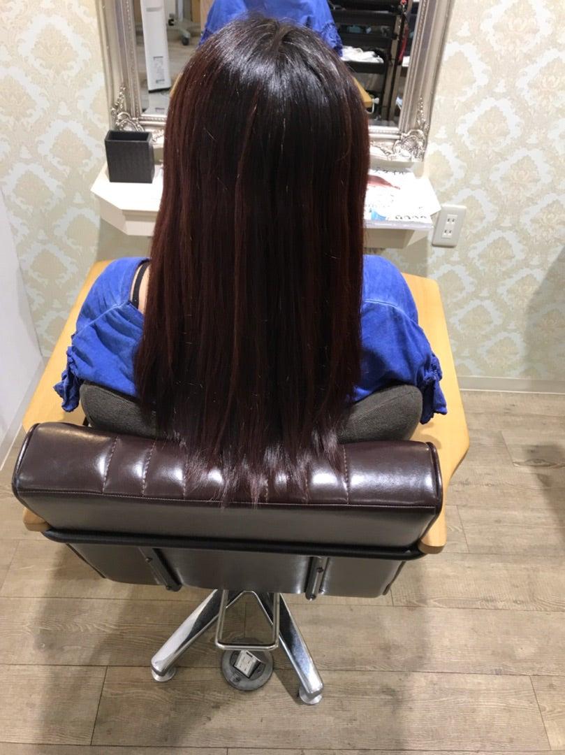 ヘナを重ねた毛先の赤い髪の記事より