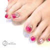 鮮やかピンク×丸ホロのフットネイルの画像