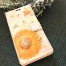 オレンジのガーベラが華やかに!手帳型スマホケースの記事より