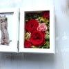 赤バラのフォトフレームの画像
