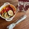 オムライス弁当とカニクリームコロッケの画像