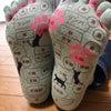 反射区の書いてある靴下。の画像