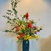 総務部より 「10月 院内のお花 」 曲線がとても美しい作品となりました