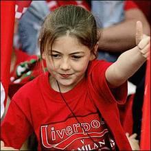 parade_a girl sticks her thumb up